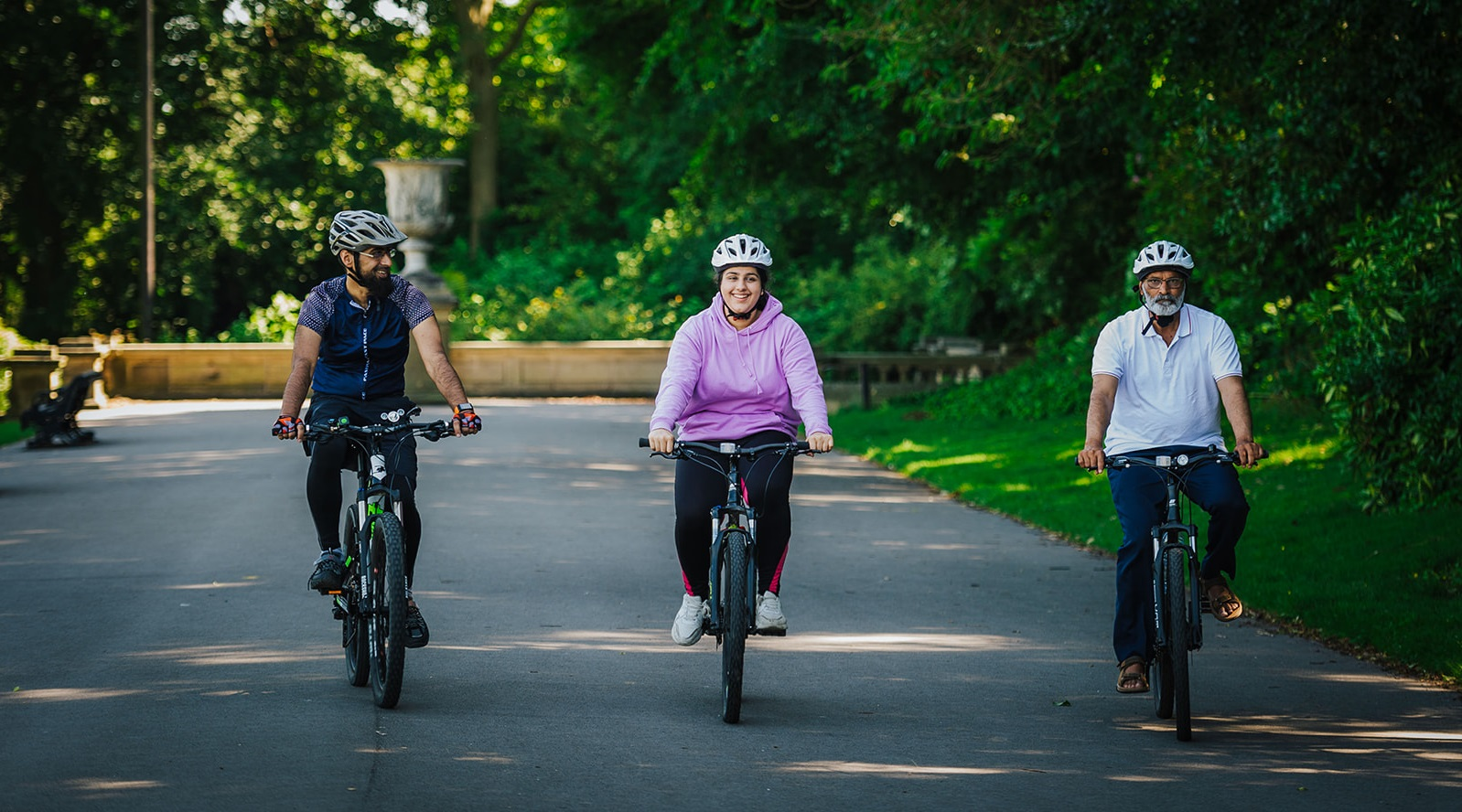 Three Calderdale residents riding bikes in Park Ward
