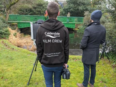 A shot of the CMBC design team watching a photoshoot unfold in People's Park,Halifax
